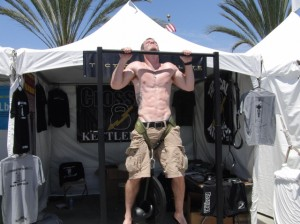 Zach completing 6 pull-ups with 90#s at 2010 CF Games